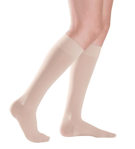 Magic calf length socks in beige with closed toe.