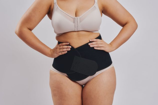 BodyAid black abdominal binder. Leonisa posture bra with rear criss-cross support bands in beige. Instant Leonisa booty boosting padded beige panties.