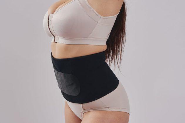 BodyAid black abdominal binder with self-adjusting velcro closure. Leonisa posture bra in beige.