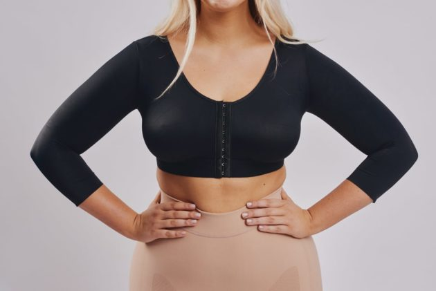 BodyAid arm compress crop in black with 3/4 sleeves and posture support. For Brachioplasty or Liposuction to the arms. Recover in comfort.
