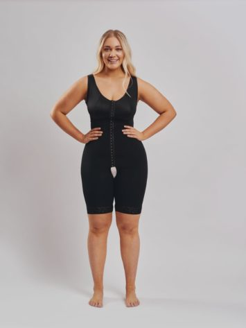 BodyAid Black post-operative bodysuit with built-in bra for extra comfort. Front adjustable hook and eye closure with an open crotch.