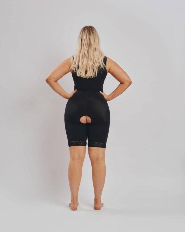 BodyAid Black post-operative bodysuit with built-in bra for extra comfort. Open crotch and non compressive butt lift shape support Rear view.
