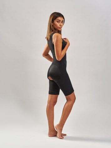 BodyAid slimmer bodysuit with bra in black. Open crotch and non compressive butt lift shape support. Non roll lace hem.