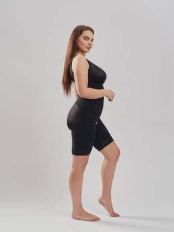 BodyAid black post-operative comfort bodysuit built-in bra extra support. Three row front hook & eye closure. Open crotch & non compressive butt lift shape side view.