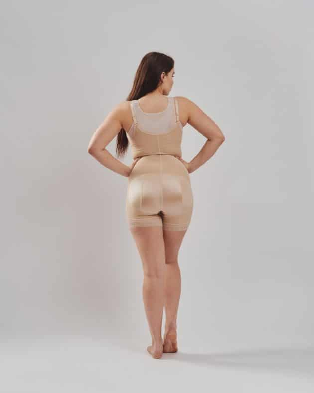 BodyAid boy leg bodysuit in beige with front zip. Open crotch and non compressive butt lift shape support Rear view. Leonisa posture bra back support in beige.