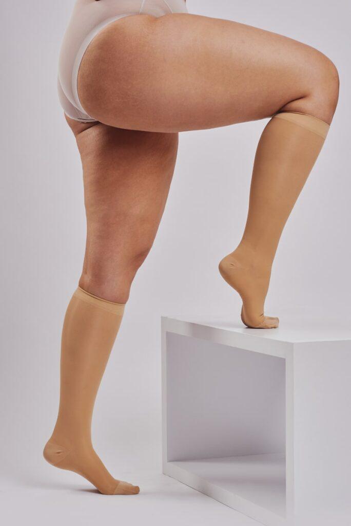 BodyAid sheer knee high medical grade graduated compression socks in beige.