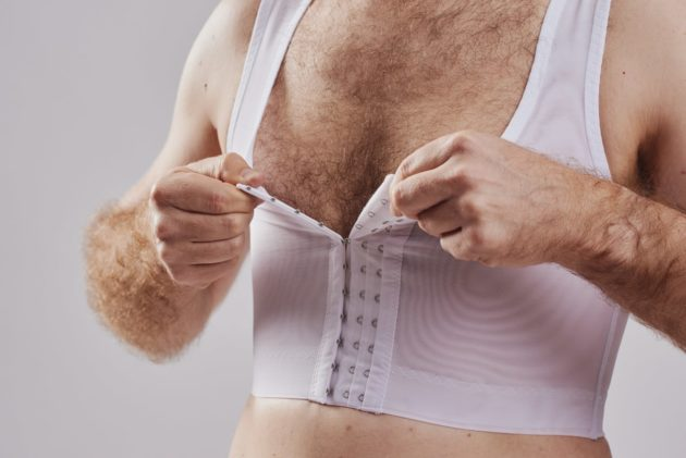 BodyAid chest compression binder in white. Features adjustable front hook and eye closure.