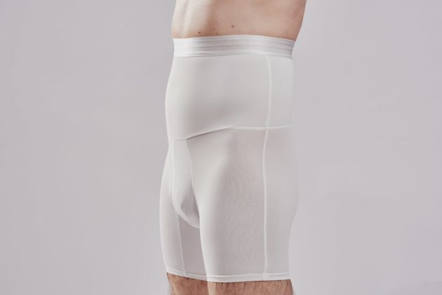 BodyAid male white high waist shaper shorts. Double layer abdominal compression. Side view.