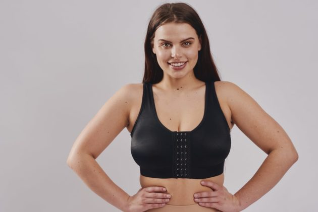 BodyAid stabilizer bra in black. Front adjustable hook and eye closure. One cup fits all.