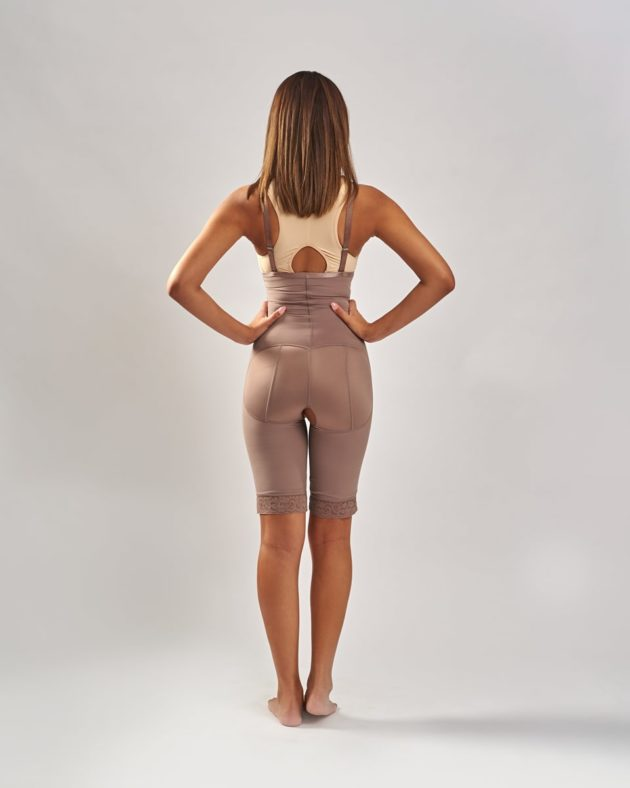 BodyAid Tummy trainer bodysuit in natural with non compressive butt lift shape support. Adjustable removable shoulder straps.