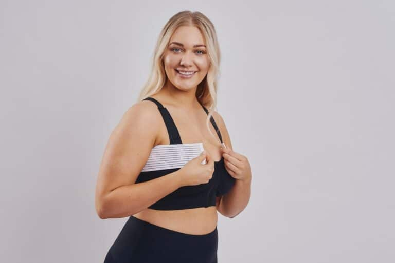 Cleapoint Medical Adjustable white stabilizer band for sustained implant positioning. BodyAid black soft front fastening comfortable post op bra.