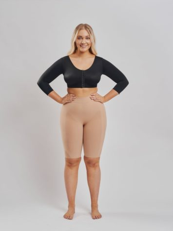 BodyAid arm compress crop in black with 3/4 sleeves and posture support. Butt lift shaper shorts in beige. With targeted compression