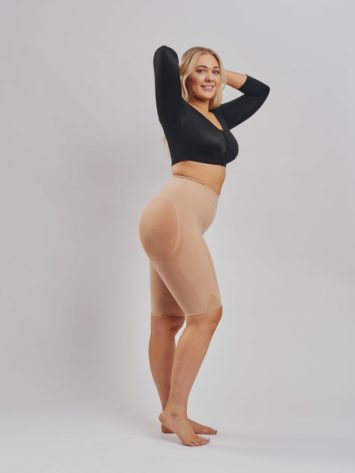 Side view of well Leonisa rounded invisible butt lift shaper shorts in beige. The backside is made with sheer mesh to avoid flattening. BodyAid arm compress crop in black.