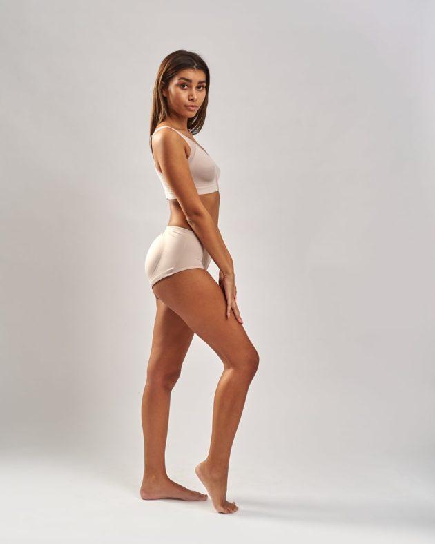 Leonisa instant butt lift panties. Side view instant Leonisa booty boosting padded beige panties. Leonisa posture bra in beige.