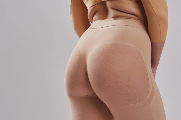 Well rounded invisible Leonisa butt lift shaper shorts in beige. The backside is made with sheer mesh to avoid flattening. Rear view.
