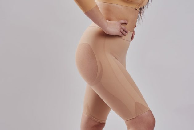 Well rounded invisible Leonisa butt lift shaper shorts in beige. The backside is made with sheer mesh to avoid flattening. Side view.
