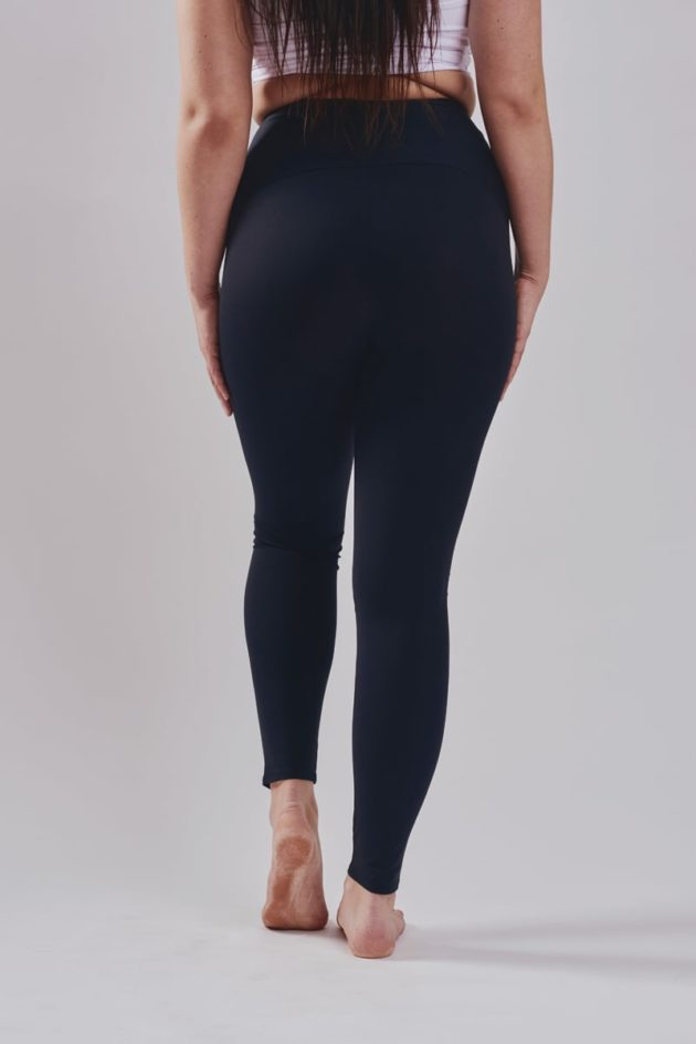 Leonisa mid-rise leggings in black with extra lower abdominal compression.