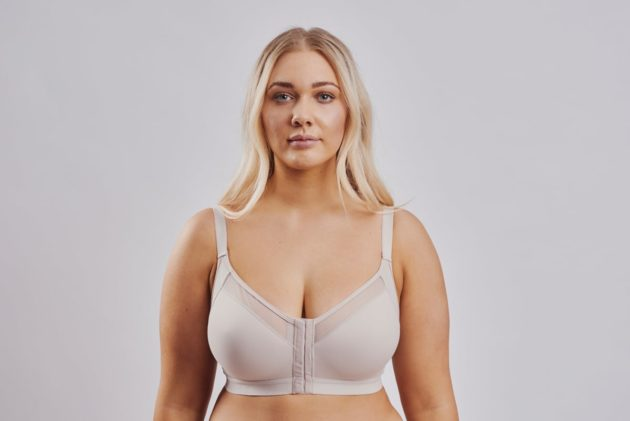 Leonisa posture bra with criss-cross bands in beige. Full bust coverage and front hook and eye closure.