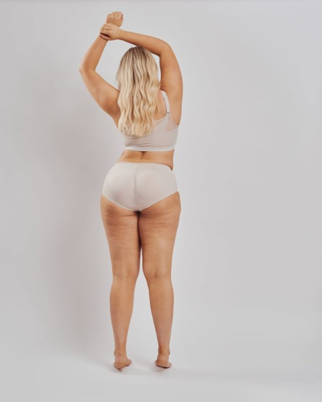 Instant Leonisa booty boosting padded beige panties. Removable butt pads to further add volume and shape to your behind without surgery. Rear view with leonisa posture bra with support bands in beige.