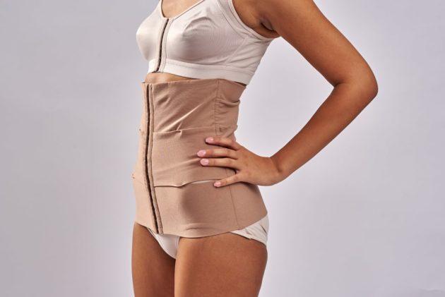BodyAid Three panel tummy trainer abdominal binder in beige for abdominal support. Leonisa front fastening posture bra in beige.