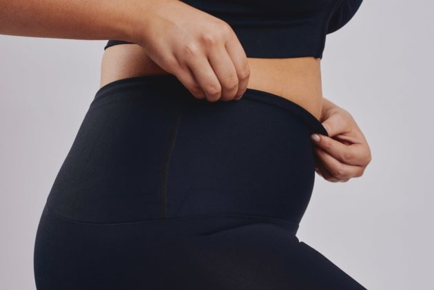 Leonisa Black activewear shorts with waistband compression to comfortably sculpt tummy region. Non-roll waistband.