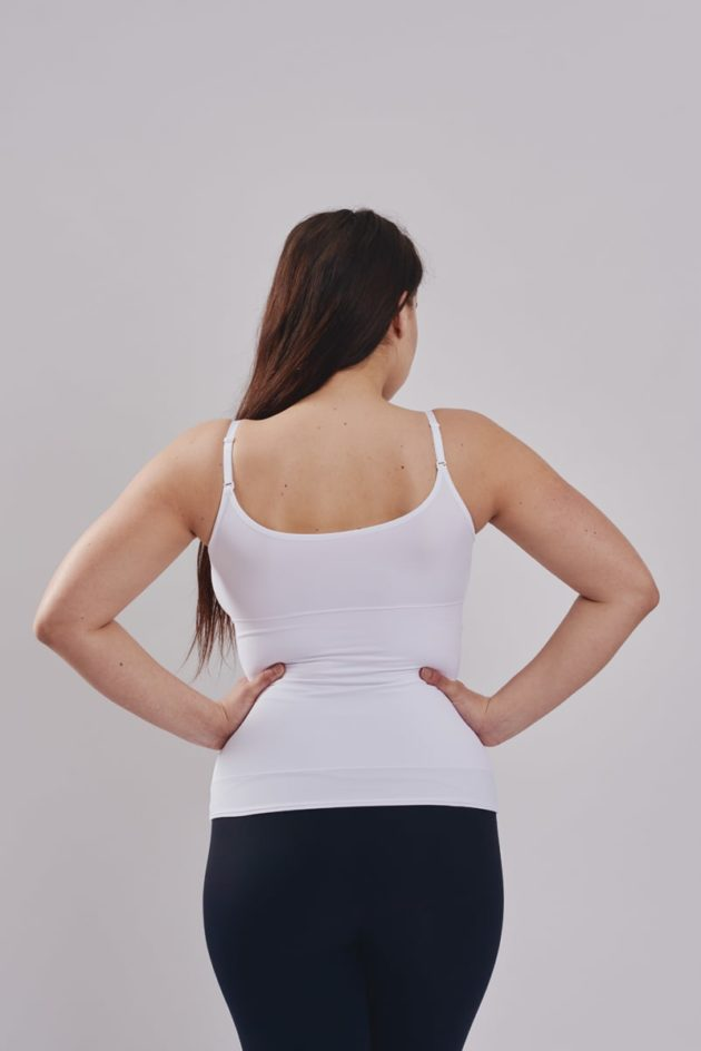 Rear view Leonisa slimming compression activewear tank in white. Shapes the torso with minimal bust compression.
