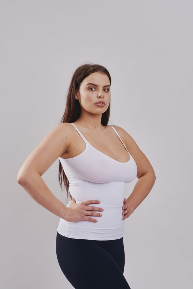 Leonisa slimming compression tank in white. Shapes the torso with minimal bust compression.