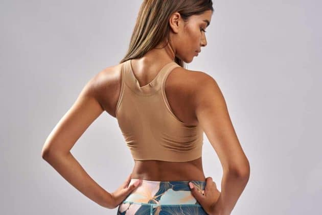 BodyAid comfort bra in beige. Soft front comfortable fastening post op bra. Highly adjustable. One cup size fitsall. Racer back for extra comfort.